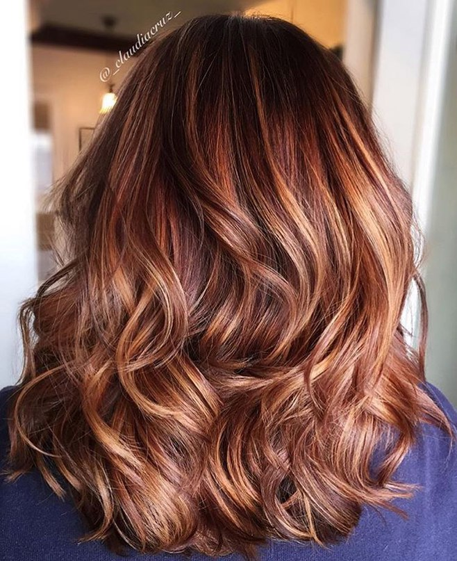 layered wavy hairtyle with red and blonde streaks