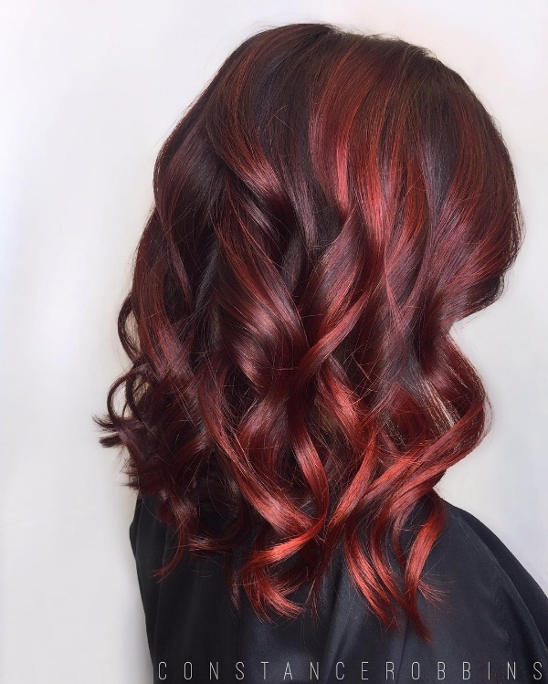 Beautiful hair! Dark brown base with bright blonde and red highlights.  Created b.