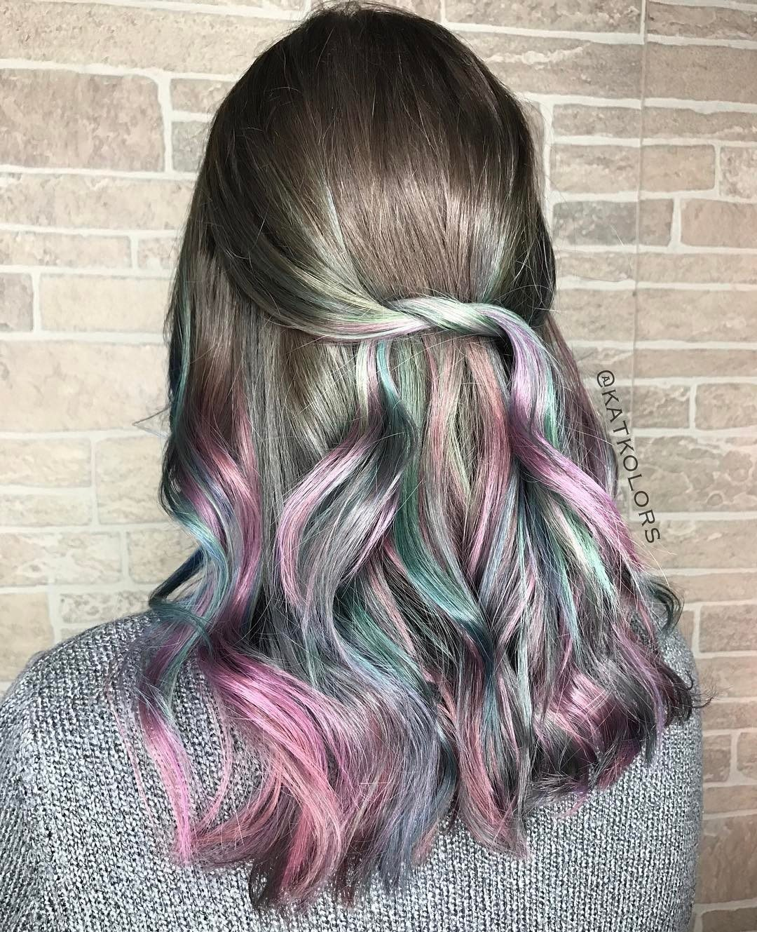dark brown hair with purple pastel highlights