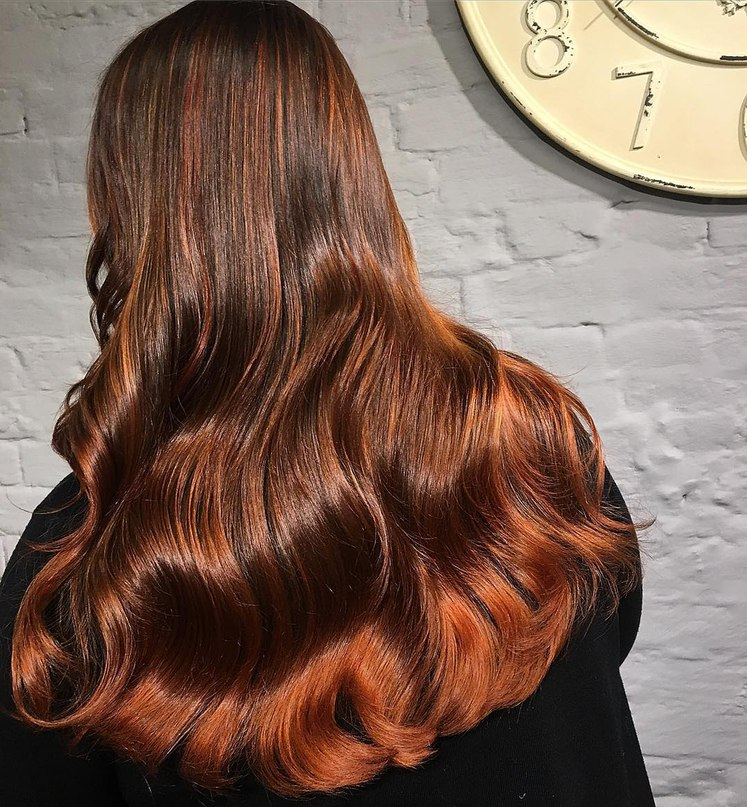 Fiery ginger ombre on a chocolate brown hair