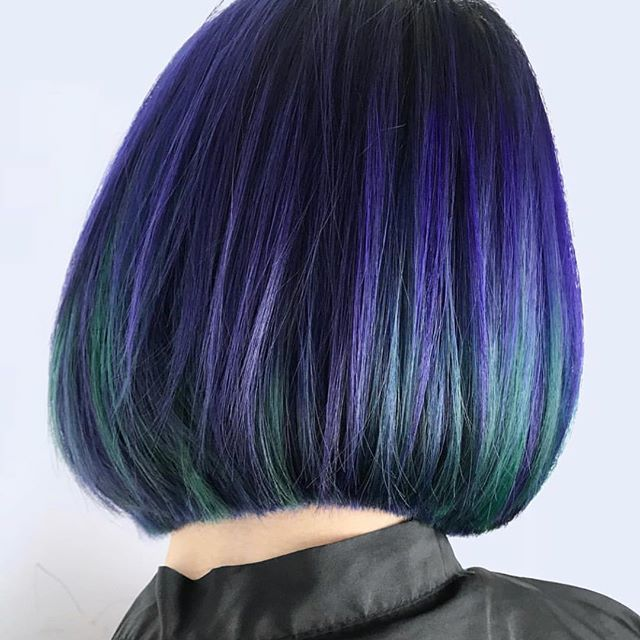 dark brown hair with green and purple highlights